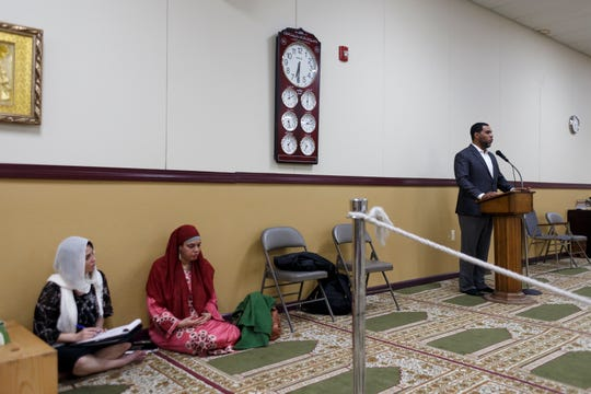 Dawud Walid, executive director of the Council on American-Islamic Relations or CAIR, speaks to community members about Imam Luqman Abdullah on Saturday at The Muslim Center in Detroit.