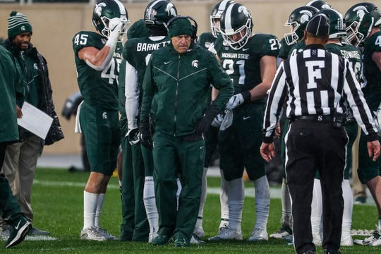 Michigan State head coach Mark Dantonio talks to players during a timeout in the second half at Spartan Stadium in East Lansing, Saturday, October 26, 2019.