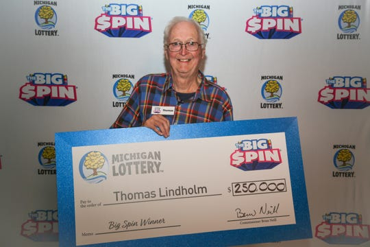"Thomas Lindholm, 72, of Otsego County won $250,000 on Michigan Lottery's ""The Big Spin"" show."