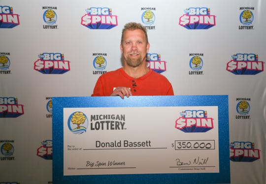 "Donald Bassett, 54, of Mecosta County won $350,000 on Michigan Lottery's ""The Big Spin"" show."