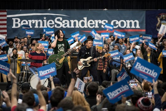 Rocker Jack White performs at his alma mater Cass Technical High School during a rally with presidential candidiate and U.S. Sen. Bernie Sanders and U.S. Rep. Rashida Tlaib in Detroit on Sunday.