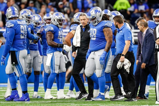 Lions defensive tackle Damon Harrison (98) walks off the field due to injury during the first half against the Giants at Ford Field in Detroit, Sunday, Oct. 27, 2019.