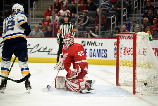 St. Louis Blues left wing Zach Sanford watches the puck go in the net past Detroit Red Wings goaltender Jonathan Bernier in the first period Sunday, Oct. 27, 2019.