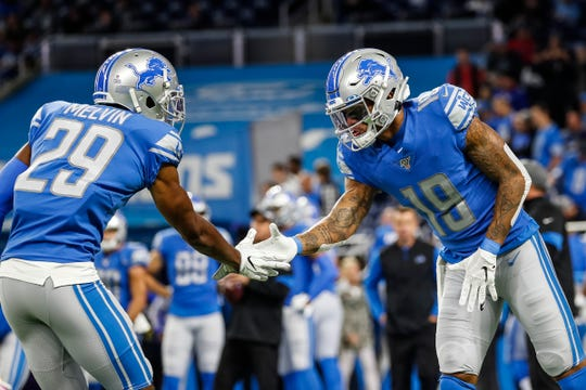 Detroit Lions cornerback Rashaan Melvin (29) and wide receiver Kenny Golladay (19) cheer each other up during warm up at Ford Field before the Giants game in Detroit, Sunday, Oct. 27, 2019.