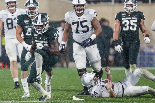 Michigan State linebacker Antjuan Simmons celebrates a sack against Penn State quarterback Sean Clifford during the second half at Spartan Stadium in East Lansing, Saturday, Oct. 26, 2019.