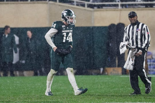 Michigan State quarterback Brian Lewerke walks off the field before a 4th down-punt against Penn State during the second half at Spartan Stadium in East Lansing, Saturday, October 26, 2019.