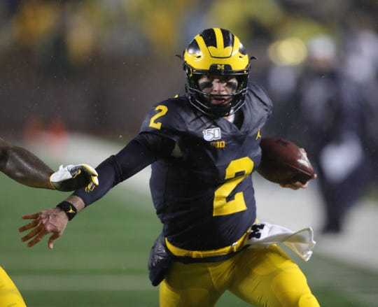 Michigan Wolverines quarterback Shea Patterson runs the ball against Notre Dame during the first half Saturday, Oct. 26, 2019 at Michigan Stadium in Ann Arbor.