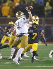 Michigan Wolverines linebacker Khaleke Hudson rushes Notre Dame quarterback Ian Book during the first half Saturday, Oct. 26, 2019 at Michigan Stadium.