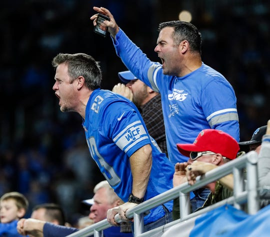 Fans cheer for the Lions during the second half of the win over the Giants on Sunday.