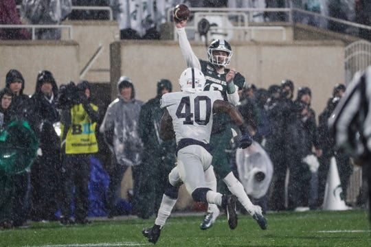 Michigan State quarterback Theo Day passes against Penn State during the second half at Spartan Stadium in East Lansing, Saturday, Oct. 26, 2019.