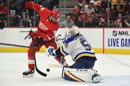 Detroit Red Wings right wing Givani Smith has the puck knocked away by St. Louis Blues goaltender Jordan Binnington in the second period Sunday, Oct. 27, 2019.