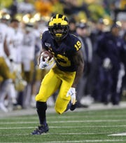 Michigan Wolverines receiver Mike Sainristil runs the ball against Notre Dame during the second half Saturday, Oct. 26, 2019 at Michigan Stadium.