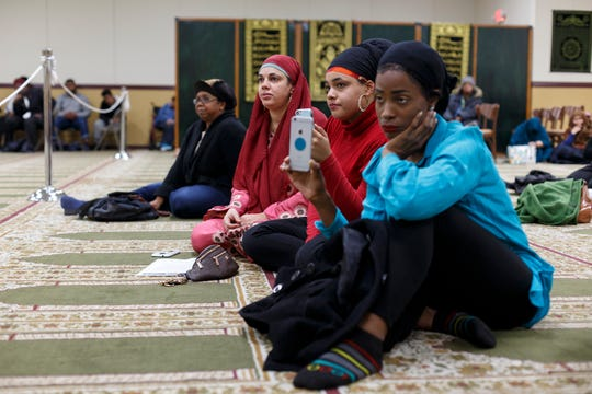From left, Qiyamah Regan, Luqman Adbullah's daughter, sits next to her daughter Yasmeenah Al-Haidar, and her niece Taahirah Abdul-Hakim during a service to remember Imam Luqman Abdullah on Saturday at The Muslim Center in Detroit.