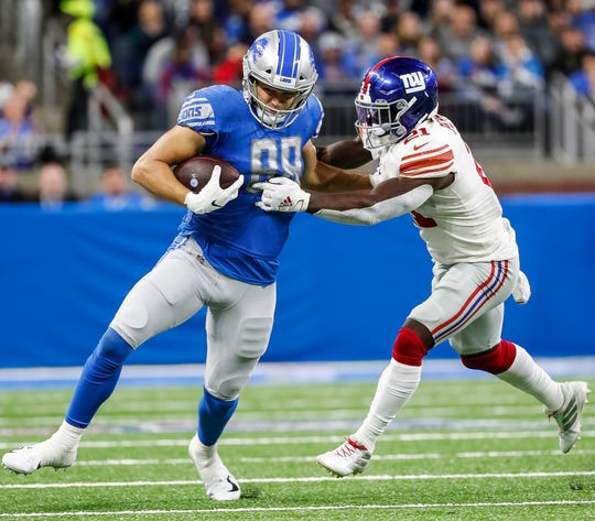 Lions tight end T.J. Hockenson runs against Giants free safety Jabrill Peppers during the first half at Ford Field in Detroit, Sunday, Oct. 27, 2019.
