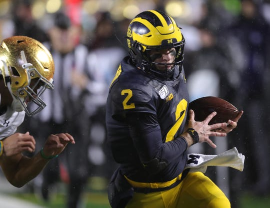 Michigan Wolverines quarterback Shea Patterson runs the ball against Notre Dame during the first half Saturday, Oct. 26, 2019 at Michigan Stadium.
