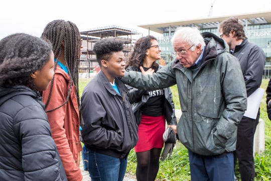 U.S. Senator and presidential candidate Bernie Sanders speaks with Ashley Johnson, 16, of Detroit Area Youth Uniting Michigan as he tours Detroit with U.S.  Rep. Rashida Tlaib on Sunday.