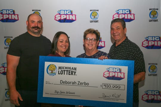 "Deborah Zerbo, 64, (second from right) of Oakland County won $400,000 on Michigan Lottery's ""The Big Spin"" show."
