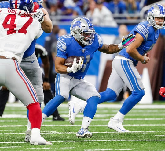 Lions running back Ty Johnson runs against the New York Giants during the second half of the Lions' 31-26 win on Sunday, Oct. 27, 2019, at Ford Field.