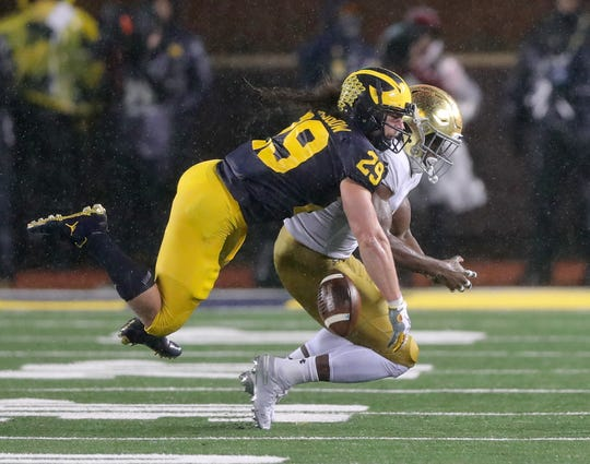 Michigan Wolverines linebacker Jordan Glasgow breaks up a pass to Notre Dame's Jafar Armstrong during the first half Saturday, Oct. 26, 2019 at Michigan Stadium.