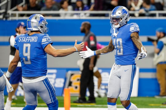 Kenny Golladay celebrates his touchdown with Matthew Stafford during the second half of the Lions' 31-26 win Sunday.