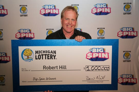 "Lapeer County man Robert Hill, 58, won $1 million on Michigan Lottery's ""The Big Spin"" show."