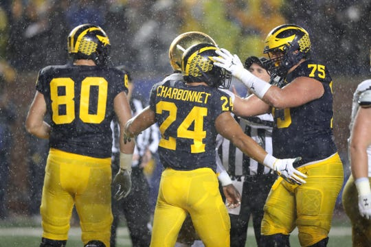 Michigan Wolverines running back Zach Charbonnet celebrates his touchdown with lineman Jon Runyan Jr. against Notre Dame during the first half Saturday, Oct. 26, 2019 at Michigan Stadium in Ann Arbor.