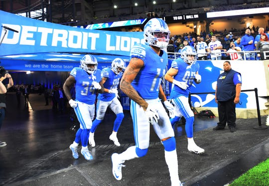 Marvin Jones Jr. and the Detroit Lions head out onto the field before the game against the New York Giants.