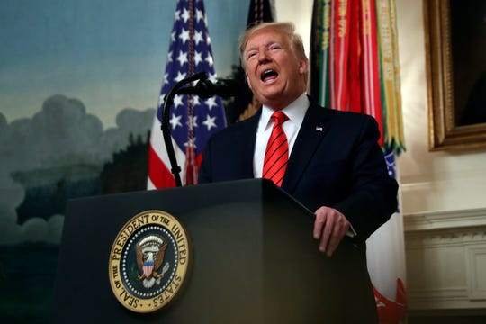 President Donald Trump speaks in the Diplomatic Room of the White House in Washington, Sunday.