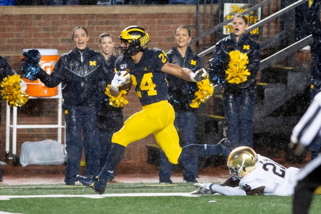 Michigan running back Zach Charbonnet is tripped up by Notre Dame safety Jalen Elliott just outside of the end zone in the first quarter.
