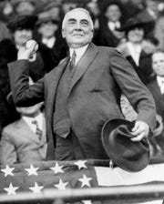 FILE - In this April 13, 1921, file photo, President Warren G. Harding throws out the first ball to open the Washington Senators' baseball season.