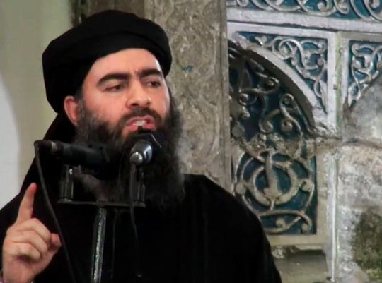 This image made from video posted on a militant website Saturday, July 5, 2014, purports to show the leader of the Islamic State group, Abu Bakr al-Baghdadi, delivering a sermon at a mosque in Iraq during his first public appearance.