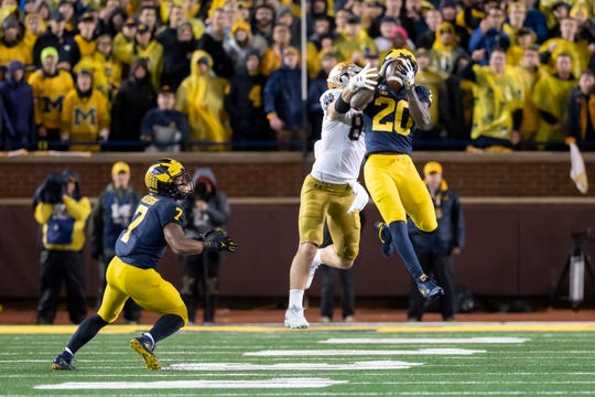 This interception by Michigan defensive back Brad Hawkins  on a pass intended for Notre Dame tight end Cole Kmet was called back due to an interference call on linebacker Khaleke Hudson, left.