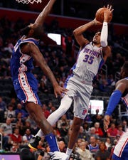Detroit Pistons forward Christian Wood (35) shoots as Philadelphia 76ers center Kyle O'Quinn defends during the first half.