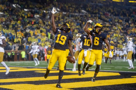 Michigan wide receiver Mike Sainristil (19) celebrates after scoring a touchdown in the fourth quarter.
