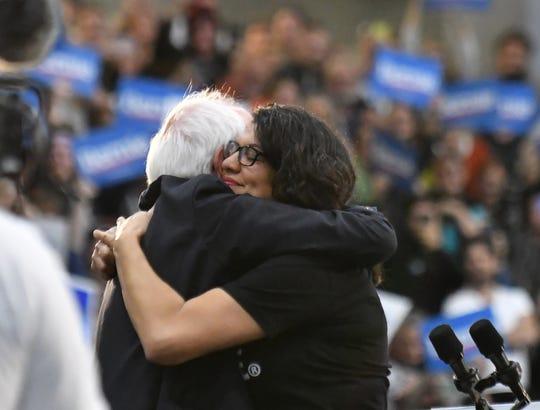 Rep. Rashida Tlaib hugs Sen. Bernie Sanders  at the Rashida Tlaib and Bernie Sanders rally at Cass Tech High School in Detroit on Oct. 27, 2019.