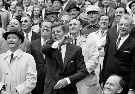 FILE - IN this April 9, 1962, file photo, President John F. Kennedy throws out the first pitch to inaugurate the 1962 American League baseball season and DC Stadium in Washington.