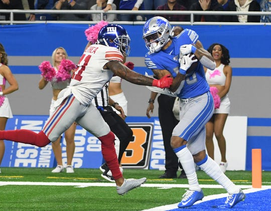 Lions' Kenny Golladay adjusts his body to make a catch in the end zone in front of Giants' Antoine Bethea in the fourth quarter.