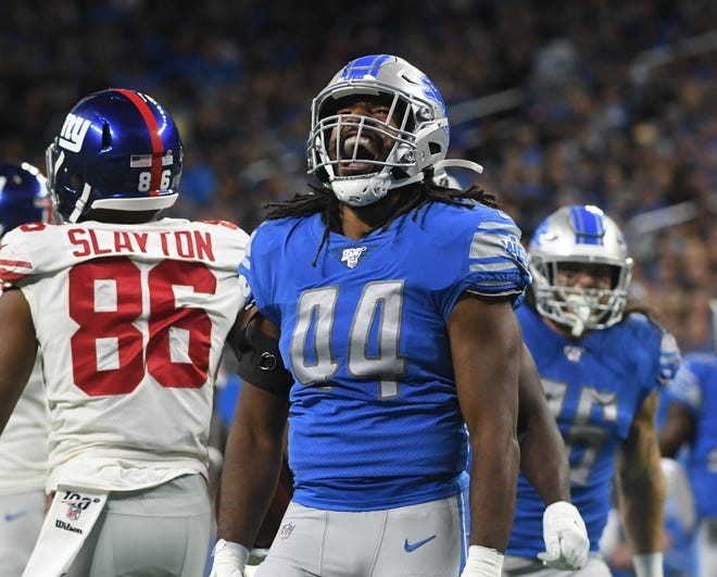 The Lions' Jalen Reeves-Maybin lets out a yell after making a tackle in the first quarter.