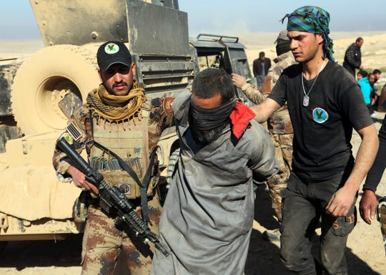 Iraqi special forces arrest a fighter with Islamic State militia Feb. 25. 2017, in Mosul, Iraq.