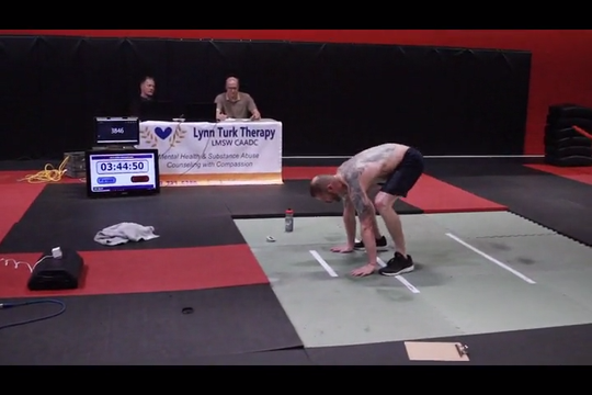 Mike Berean, 46, of Brighton attempts to break the world record for most burpees in a 12-hour span