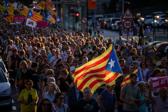 Pro-independence demonstrators march during a protest in Sabadell, near Barcelona, Spain, Saturday, Sept. 28, 2019. Several thousand people have marched in a town near Barcelona to protest the jailing of seven Catalan separatists for allegedly planning to commit violent acts of terrorism with explosives.