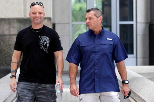 In this Thursday, Sept. 12, 2019, photo, Eric Reynolds, left, and Dave Stull, both police officers, get together in Orlando, Fla. They recently found out they were half brothers though a DNA test.