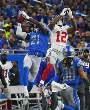 Lions' Tracy Walker intercepts a pass intended for Giants' Cody Latimer but couldn't get both feet down in bounds during the first quarter on Sunday.
