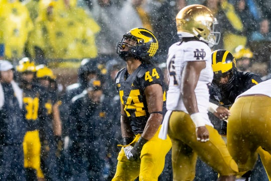Michigan linebacker Cameron McGrone celebrates after assisting on a sack in the second quarter.