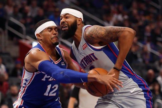 Philadelphia 76ers forward Tobias Harris (12) reaches in on Detroit Pistons forward Markieff Morris.