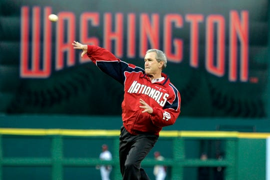 FILE - In this April 14, 2005, file photo, President George W. Bush throws out the ceremonial first pitch at the Washington Nationals home opener in Washington. The Nationals play the Arizona Diamondbacks in the first regular season baseball game in Washington in 34 years.