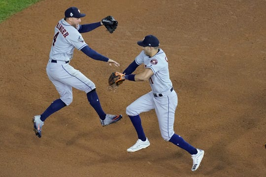 Houston Astros' George Springer and Carlos Correa celebrate after Game 4.