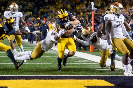 Michigan running back Tru Wilson pushes his way into the end zone for a touchdown during a run in the fourth quarter.