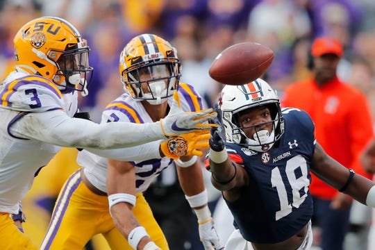 LSU cornerback Derek Stingley Jr. (24) and safety JaCoby Stevens (3) break top a pass intended for Auburn wide receiver Seth Williams (18) in the second half.