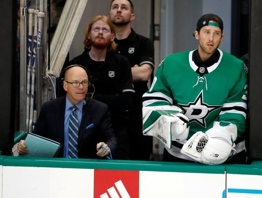 St. Louis Blues color analyst Darren Pang, left, and Dallas Stars goaltender Ben Bishop watch the play during a game in Dallas last year.